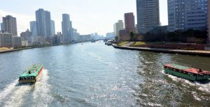 Houseboat cruising along Sumida river